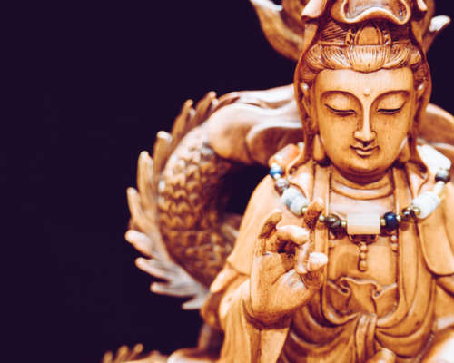 Vintage style of Buddha statue with light dark background and focus face. buddha image used as amulets of Buddhism religion.